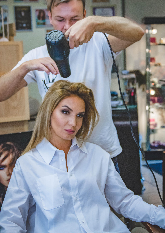 Man Drying Woman's Hair