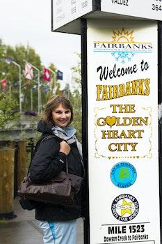 Free stock photo of tourist, lady, billboard, welcome