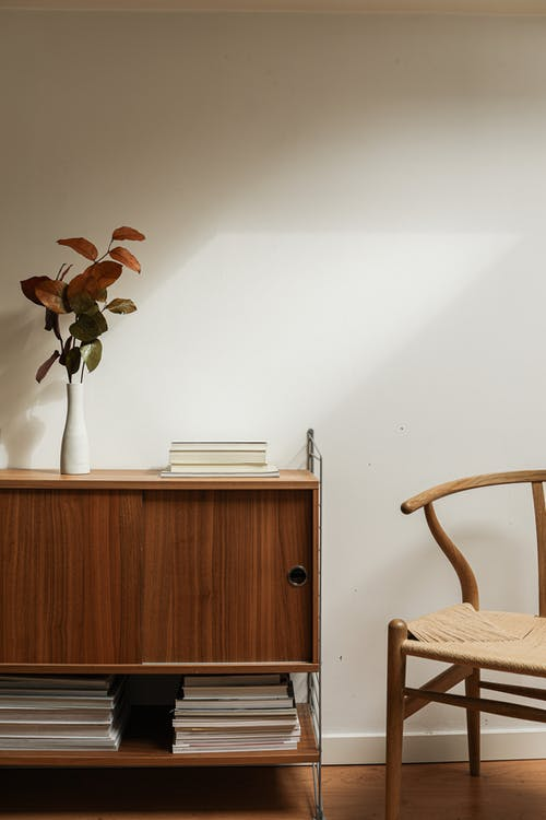 Brown Wooden Chair Beside Brown Wooden Cabinet