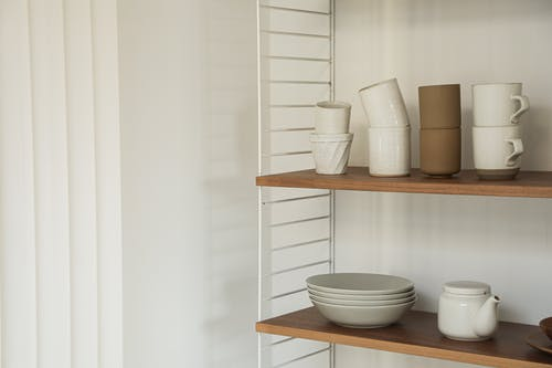 Free stock photo of architecture, bookcase, ceramic cup