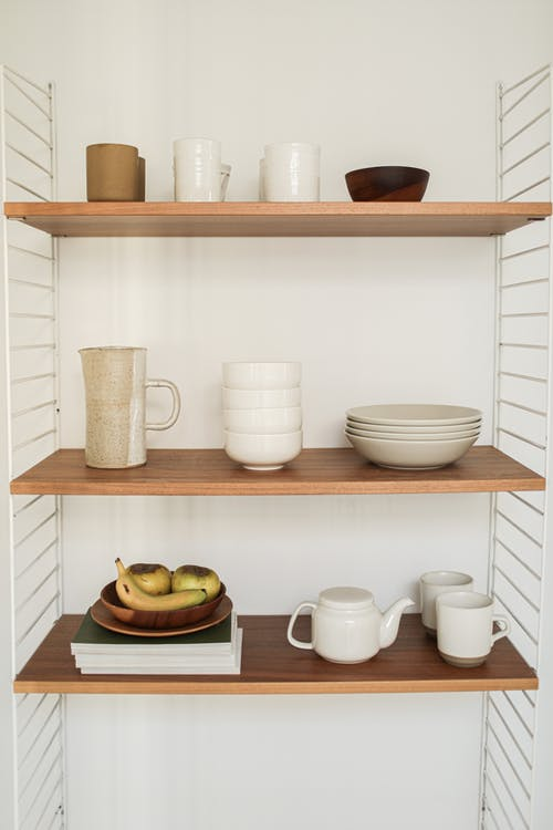 Free stock photo of bookcase, cabinet, ceramic cup