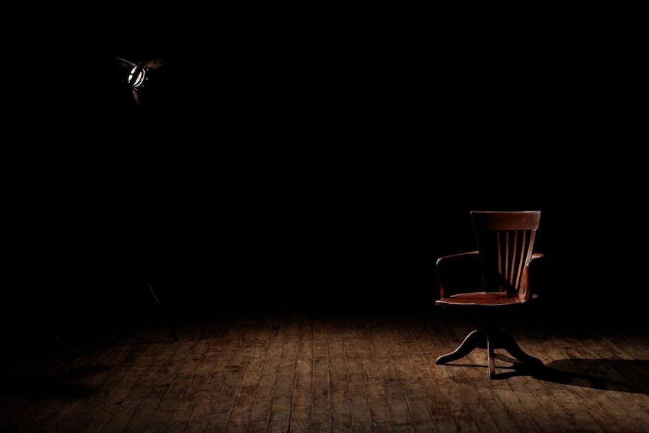 Brown wooden armchair on brown wooden floor