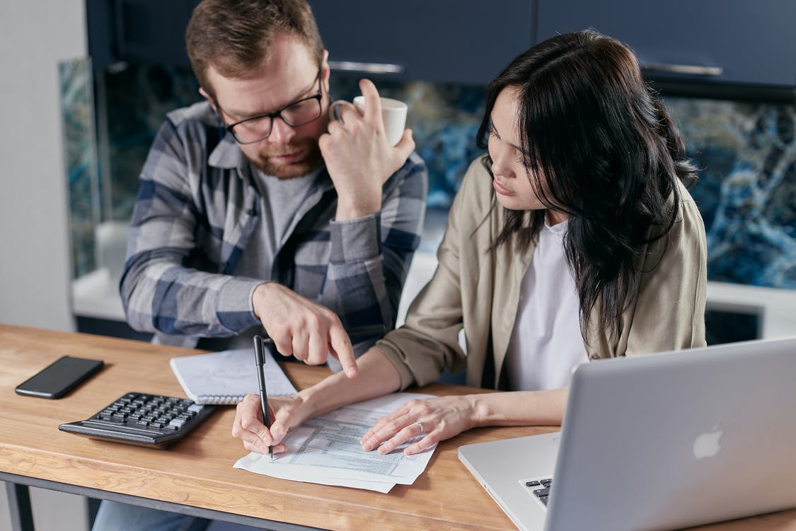 Couple Calculating all their Bills