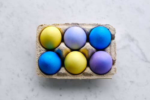 Blue Yellow and White Egg on Egg Tray