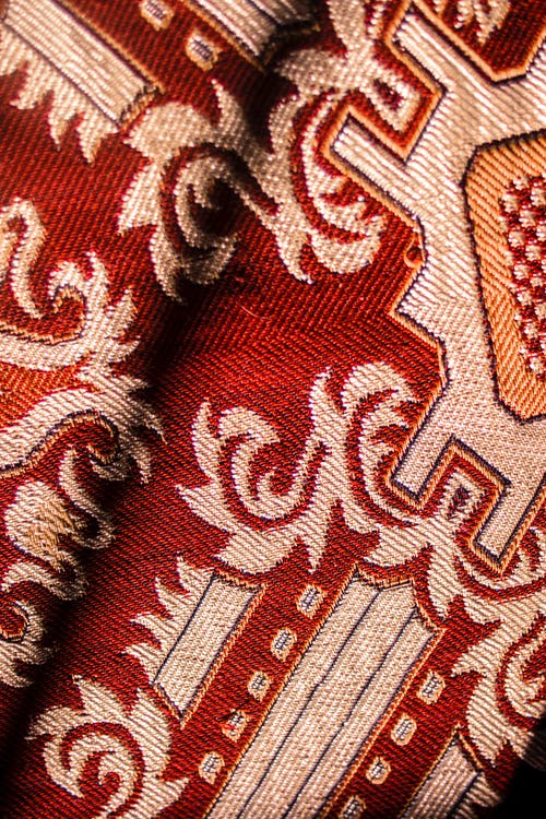 Colorful carpet with red and golden threads