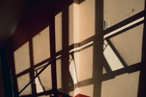 Passage of building with shadows from railings