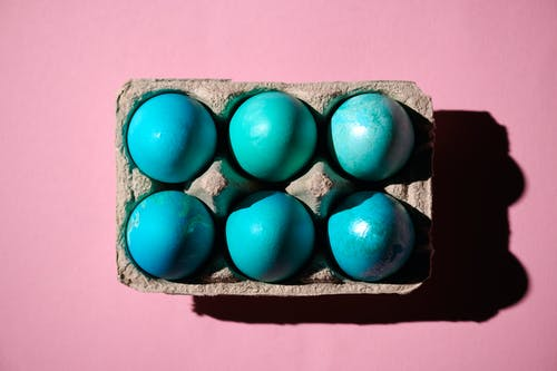 Blue Egg in Brown Box