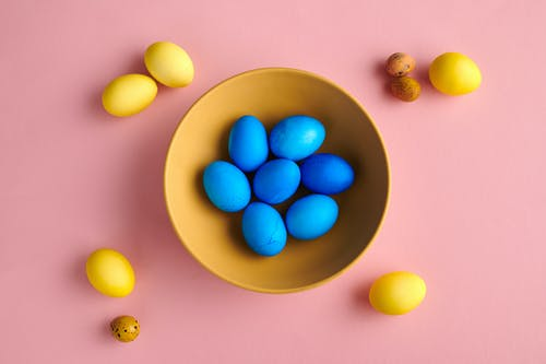 Blue Round Fruits on Yellow Ceramic Bowl