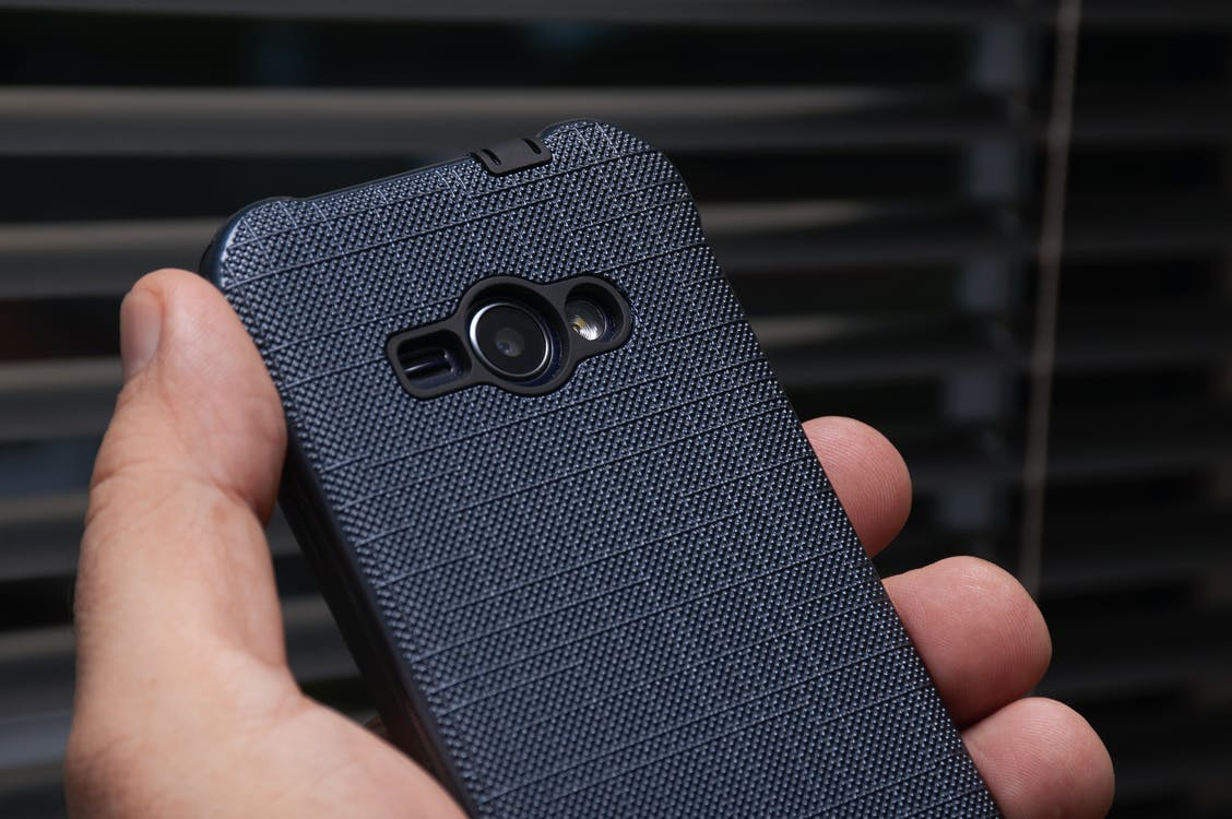 Person Holding Blue Cased Smartphone