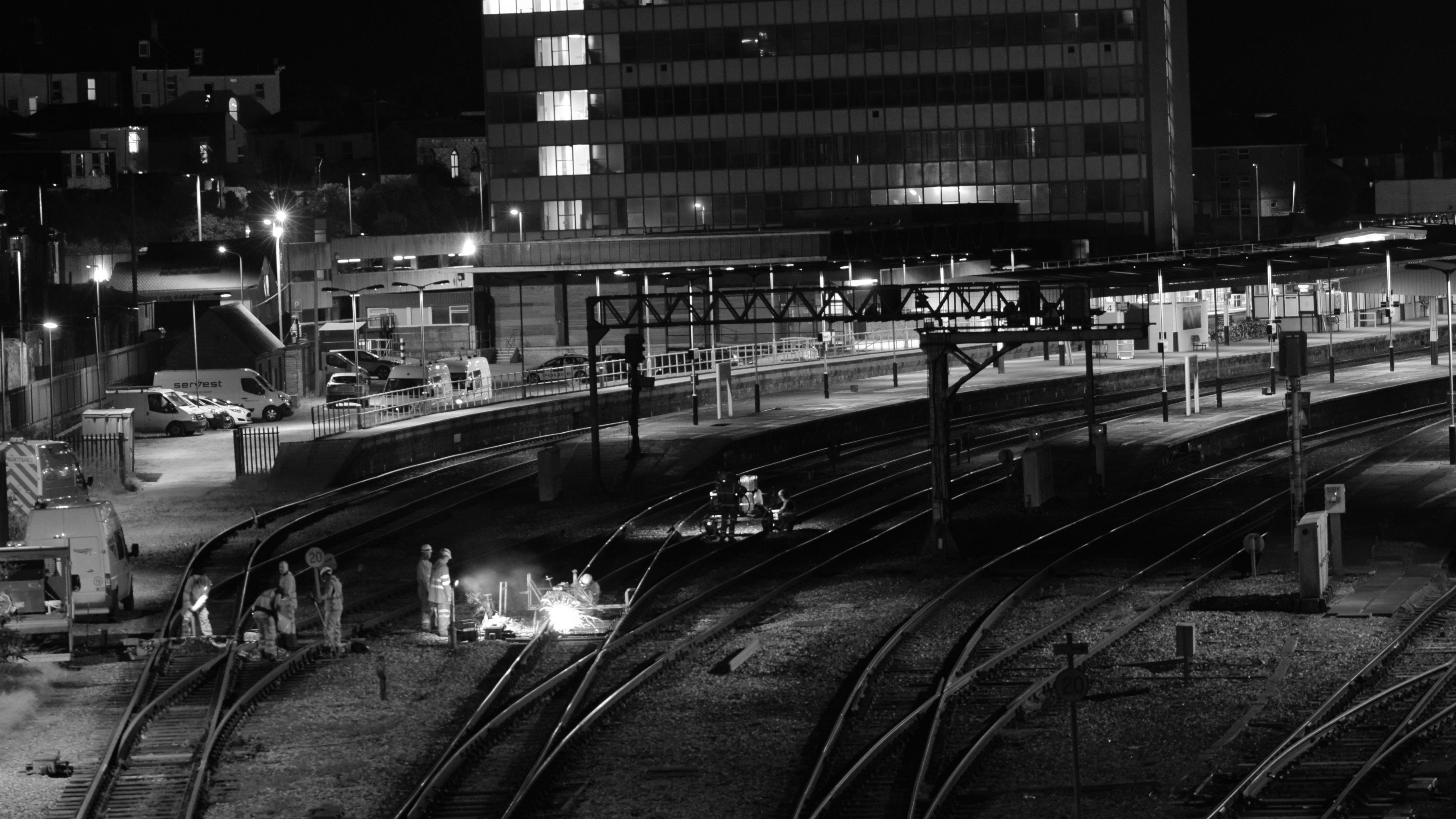 Free stock photo of black and white, cityscape, night life, railway line