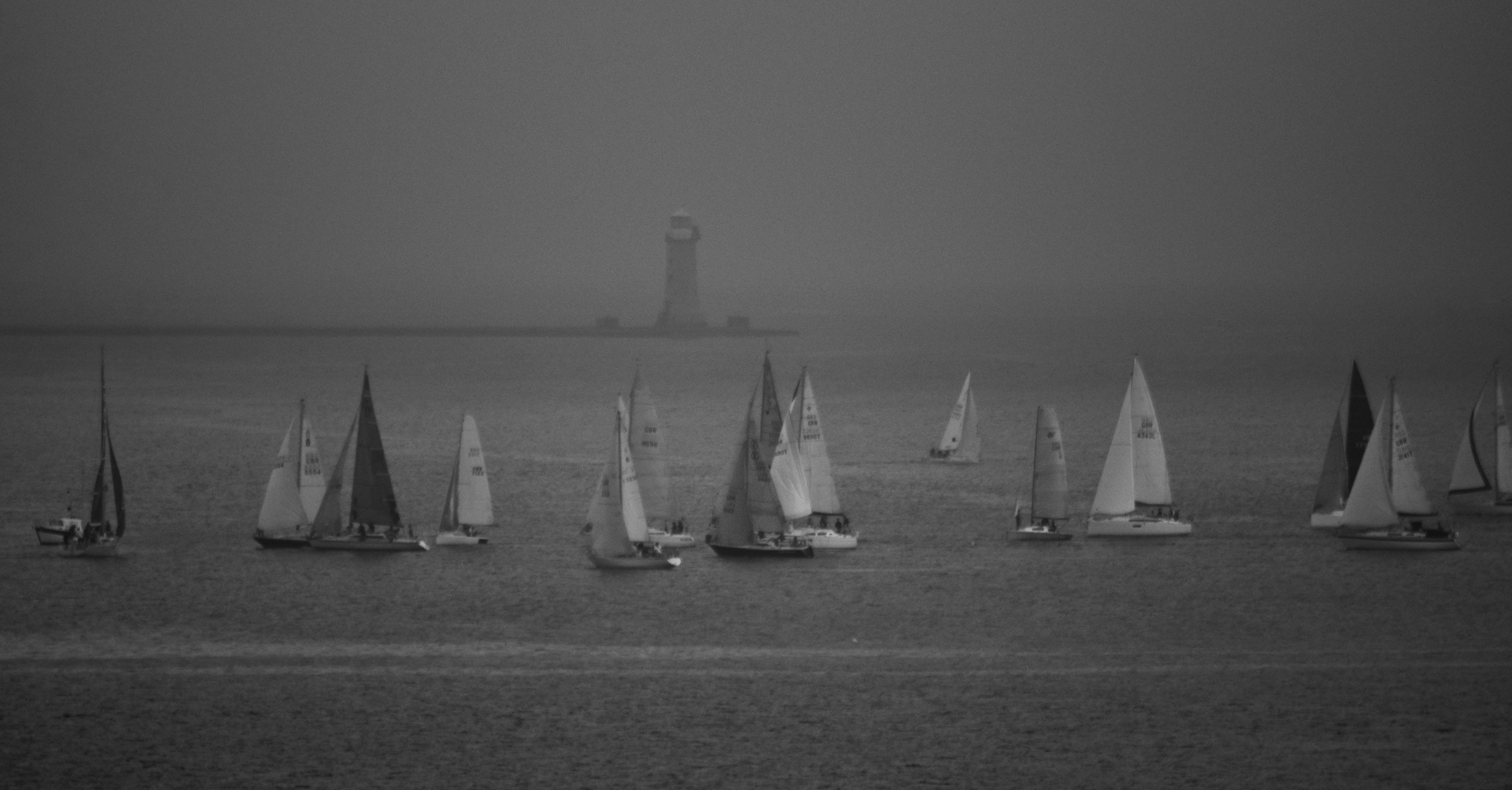 Free stock photo of black, lighthouse, sailboats, seascape