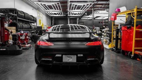 Black Honda Car in a Garage