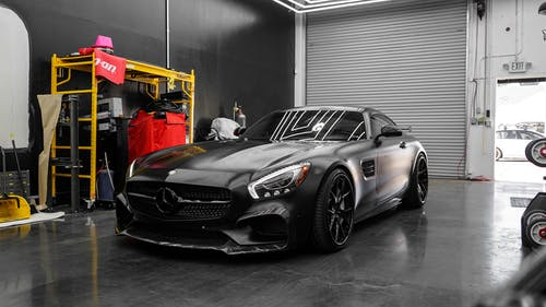 Black Mercedes Benz Coupe in a Garage