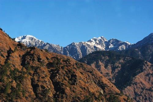 Fotobanka sbezplatnými fotkami na tému denné svetlo, dobrodružstvo, hora, horský vrchol