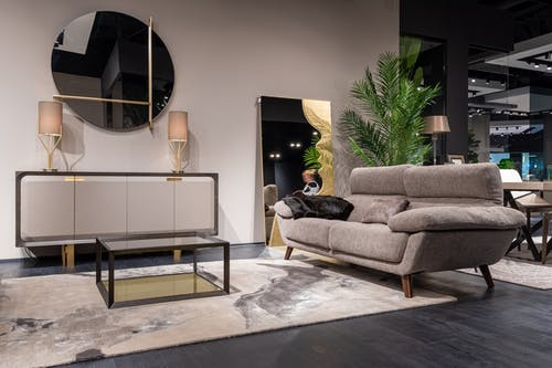 Comfortable living room with couch near glass table