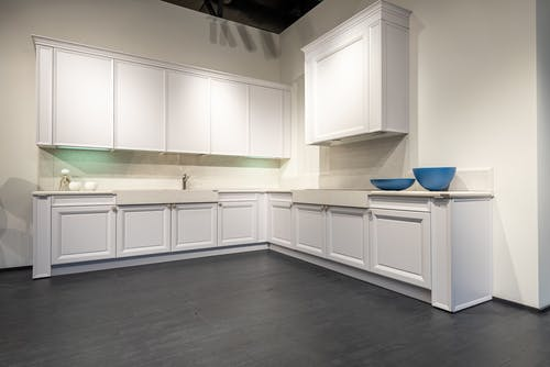 Contemporary interior with new empty units of white color on black laminate in spacious kitchen