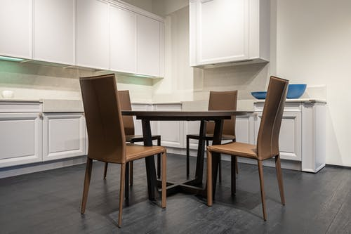 Empty dining table in modern light kitchen