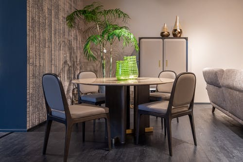 Contemporary stylish dining zone with round table and comfy chairs