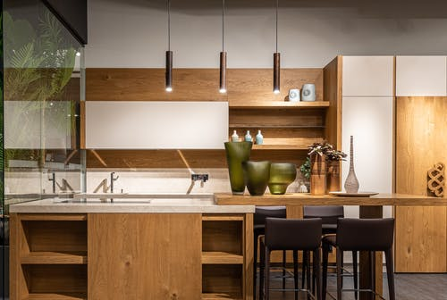 Contemporary kitchen with stylish empty furniture