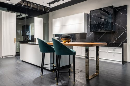 Stylish black and white kitchen furniture in modern flat