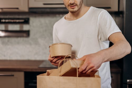 Man in White Crew Neck T-shirt Holding White Ceramic Mug