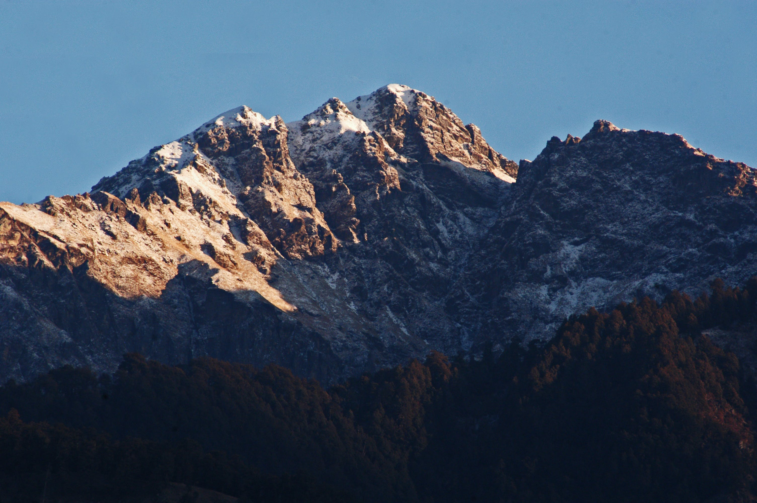 Brown and White Mountain Under Clear Sky