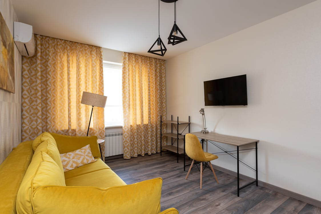 Interior of modern apartment in yellow colors