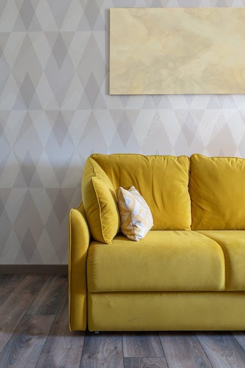 Modern room interior with sofa on parquet
