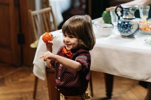 Boy Holding a Tomato
