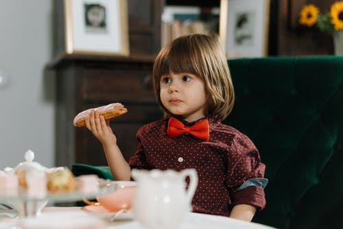 Child Eating an Eclair