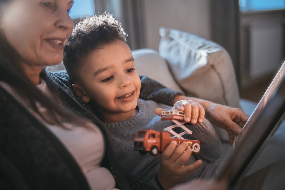 Grandmother and her grandson having fun. | Photo: Pexels