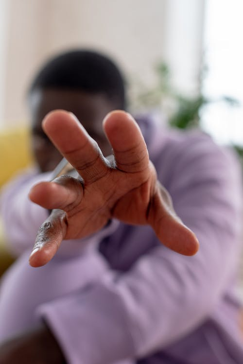 Black woman outstretching hand to camera