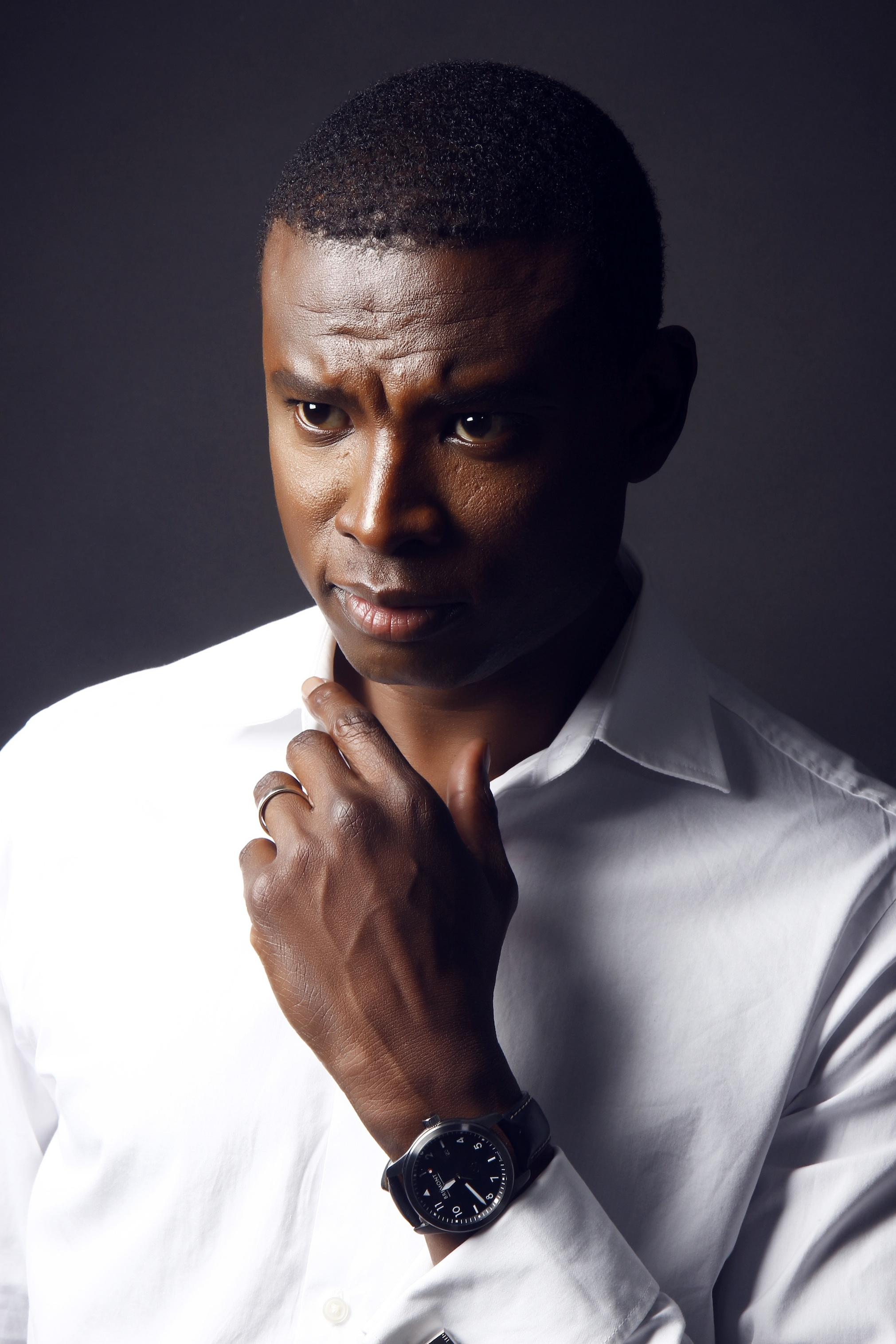 Photography of Man in White Shirt With Round Black Analog Watch