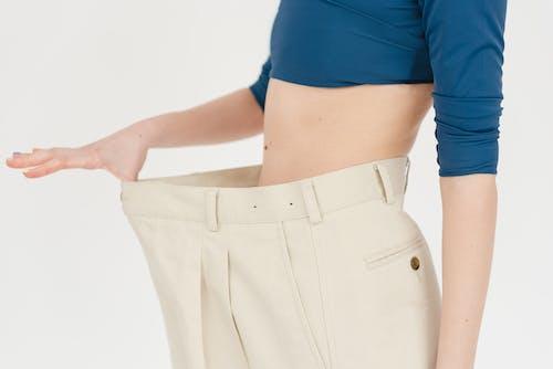 Crop woman in oversized pants