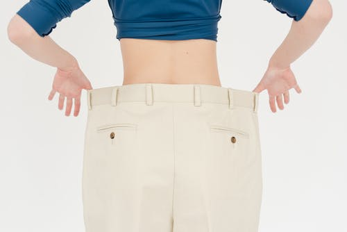 Crop slender woman in oversized pants