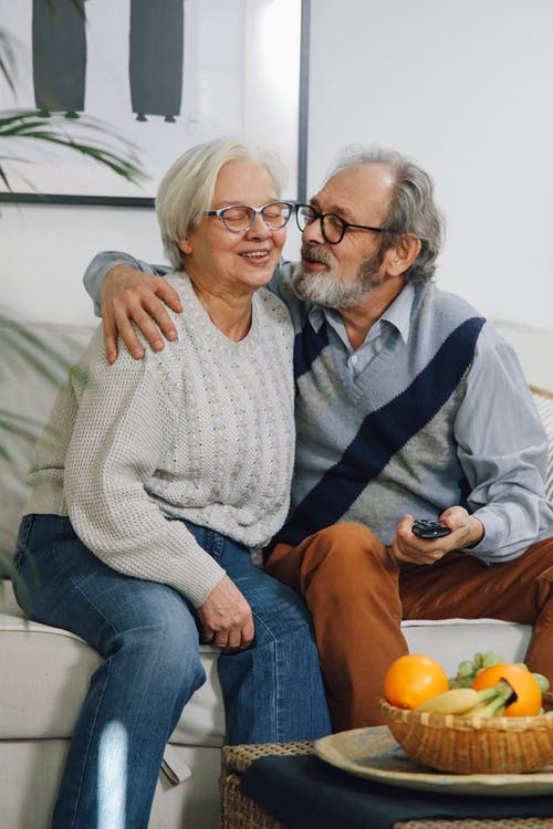 Man in Gray Sweater Beside Woman in Gray Sweater