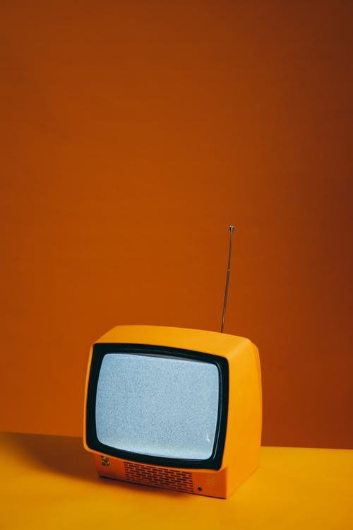 Yellow TV With Blank Screen