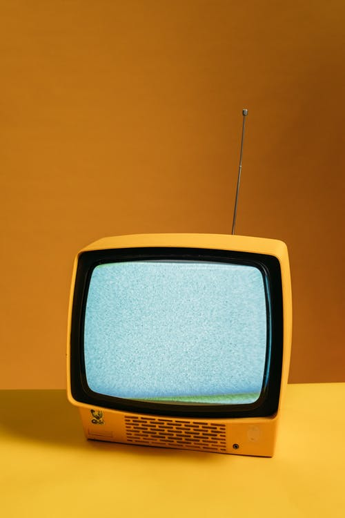 Classic Yellow TV With Blank Screen