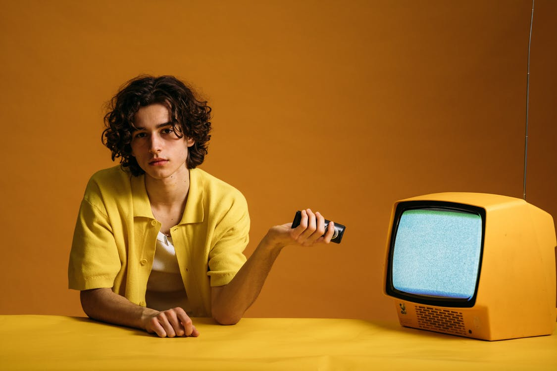 Young Man Holding A Remote Control