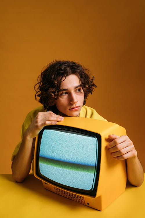 Handsome Guy Holding A Yellow Tv