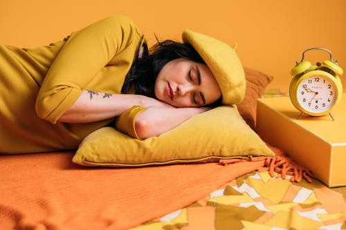 A Sleeping Woman In Yellow Outfit