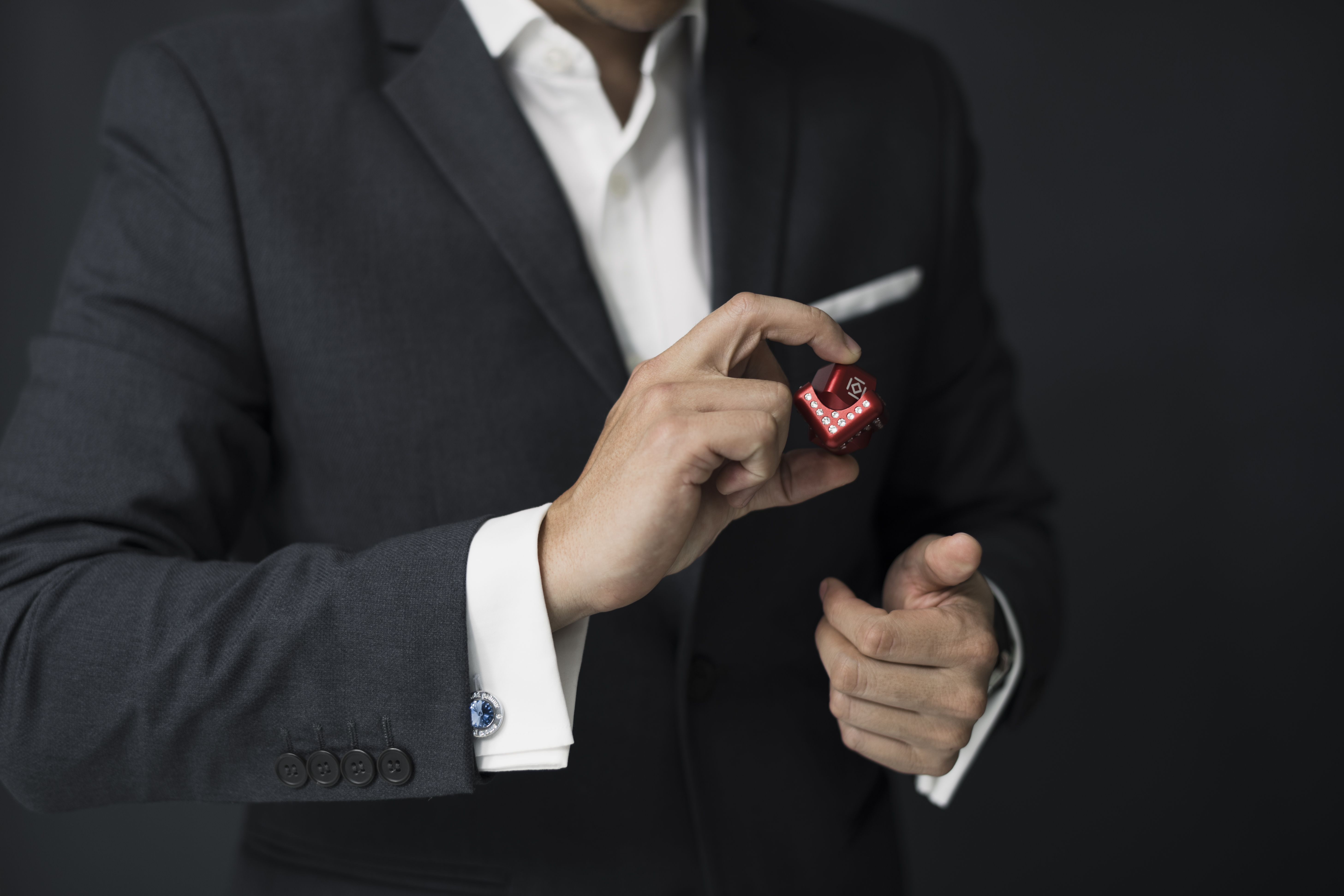 Man Holding Red Cube