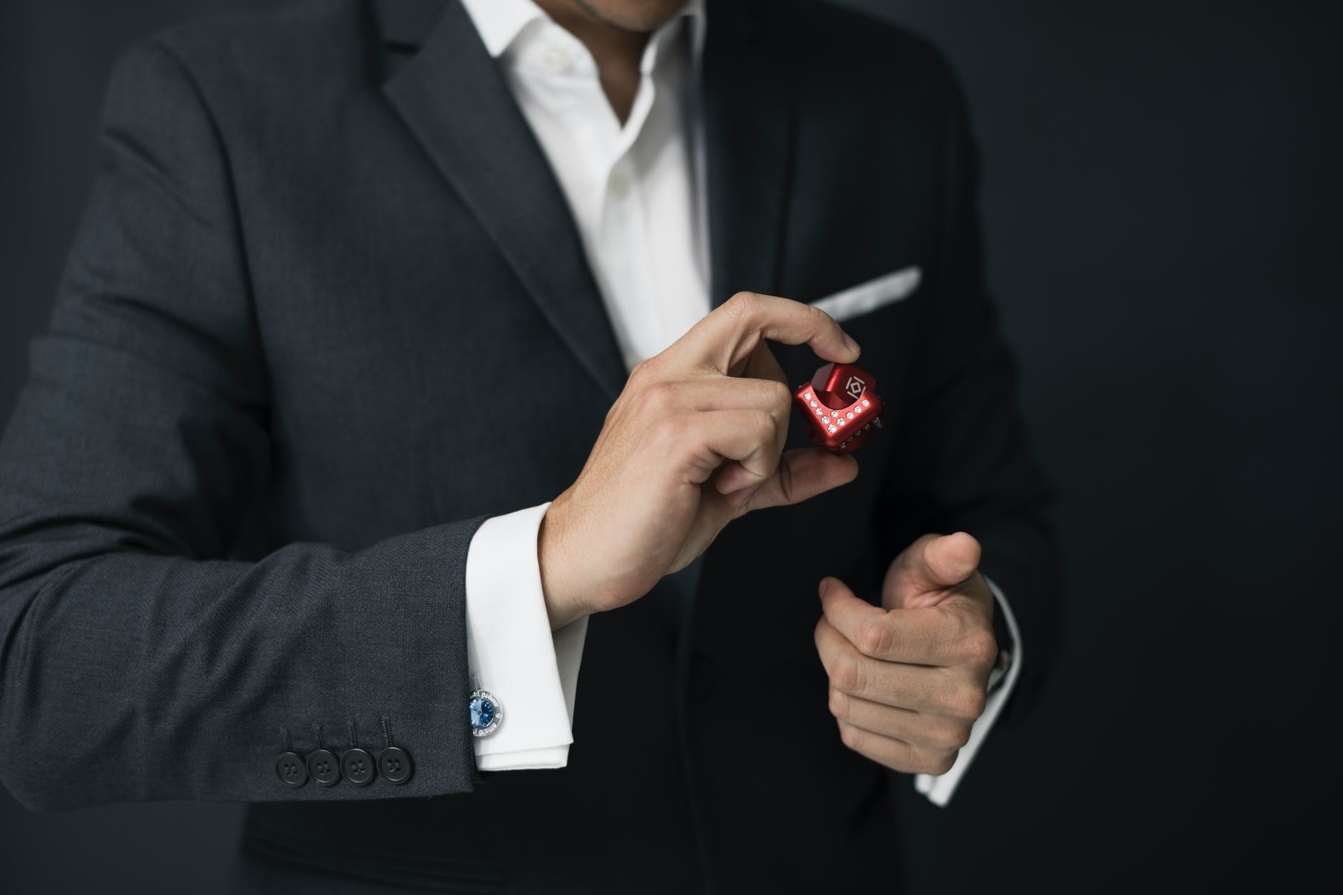 Image of a person wearing a suit with a blue cufflinks