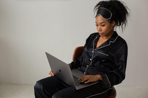 Woman in Black Pajamas Using Laptop