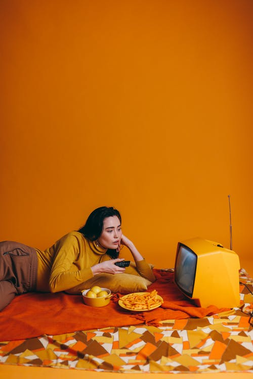 Woman In Yellow Long Sleeve Shirt Watching Tv
