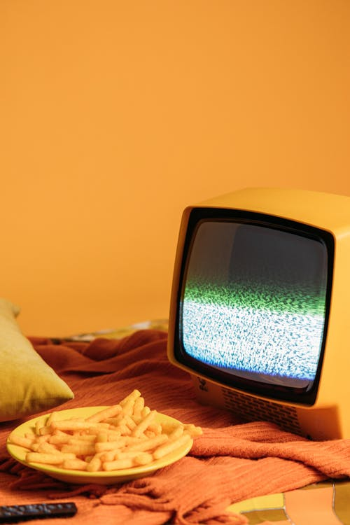 Yellow Vintage Television With Blank Screen