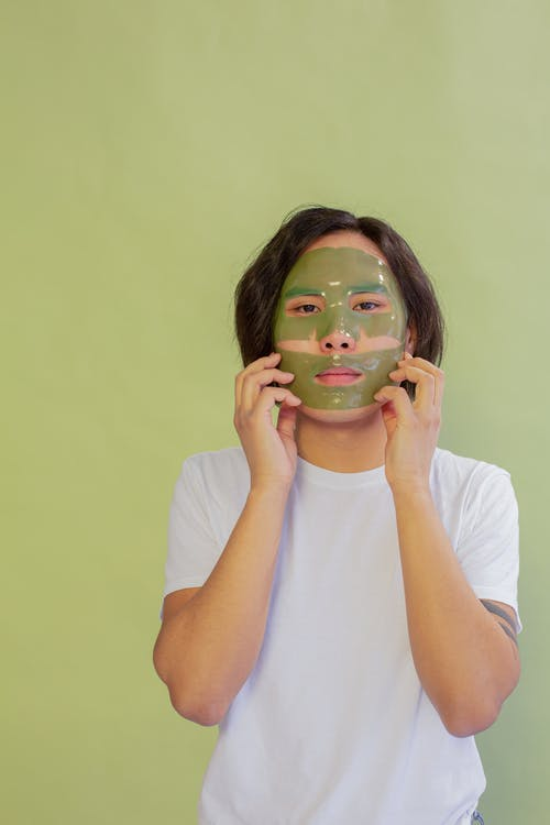 Asian man with facial mask during skincare treatment