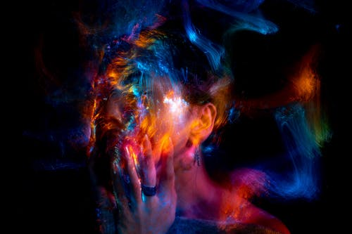 Woman With Blue and Red Powder on Her Face