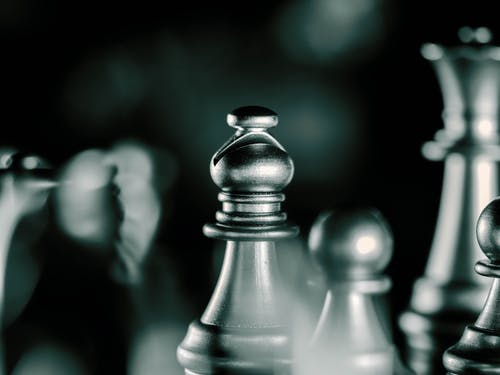 Gray Scale Photo of Chess Piece