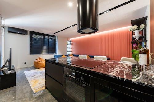 Modern kitchen interior with hob under hood at home